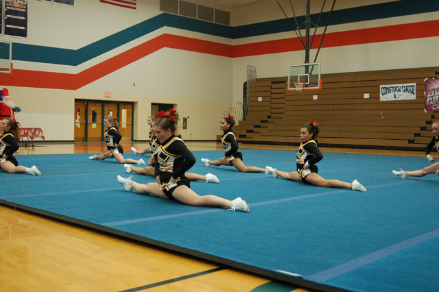 Varsity girls do their splits during round two at the annual holiday cheer bash.