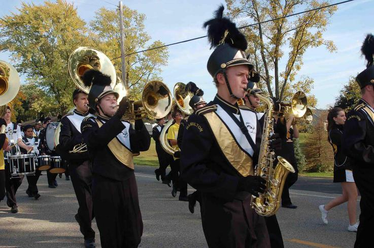 Miranda Featherstone and Austin Dams march with the brass section in the parade.