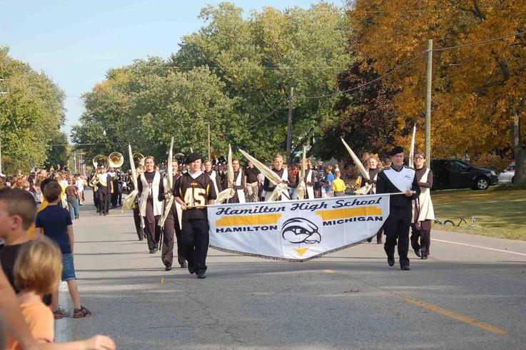 The color guard leads the marching band in Friday's Homecoming parade.