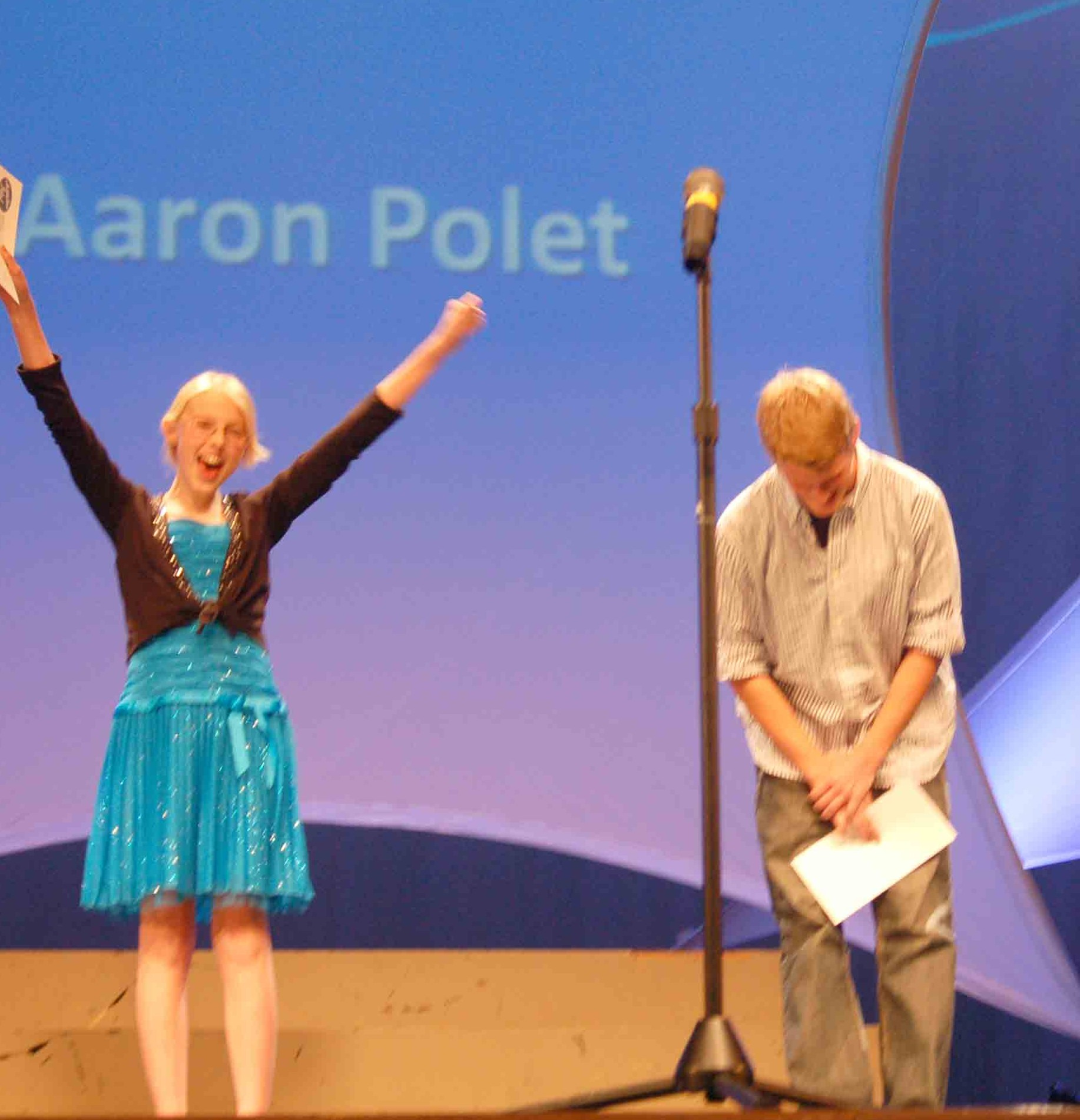 A very gracious Anna Cole celebrates the announcement that Aaron Polet has won this year's Hamilton Idol.  A humble Polet bows his head upon hearing the news.