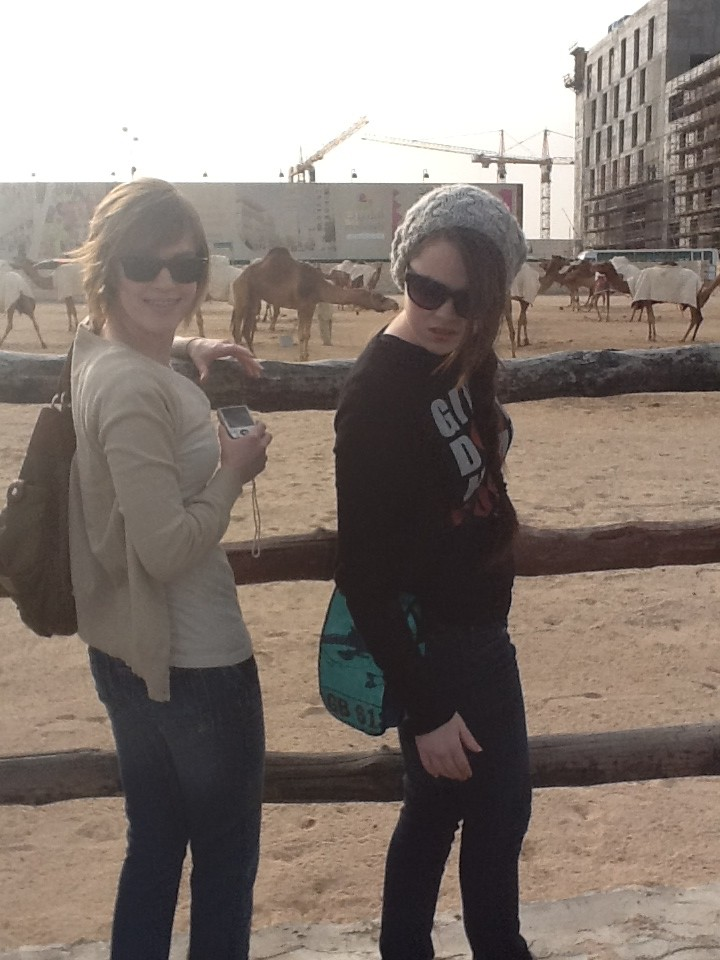Elizabeth and I are in front of the camels. Elizabeth is telling my dad not to take the picture.