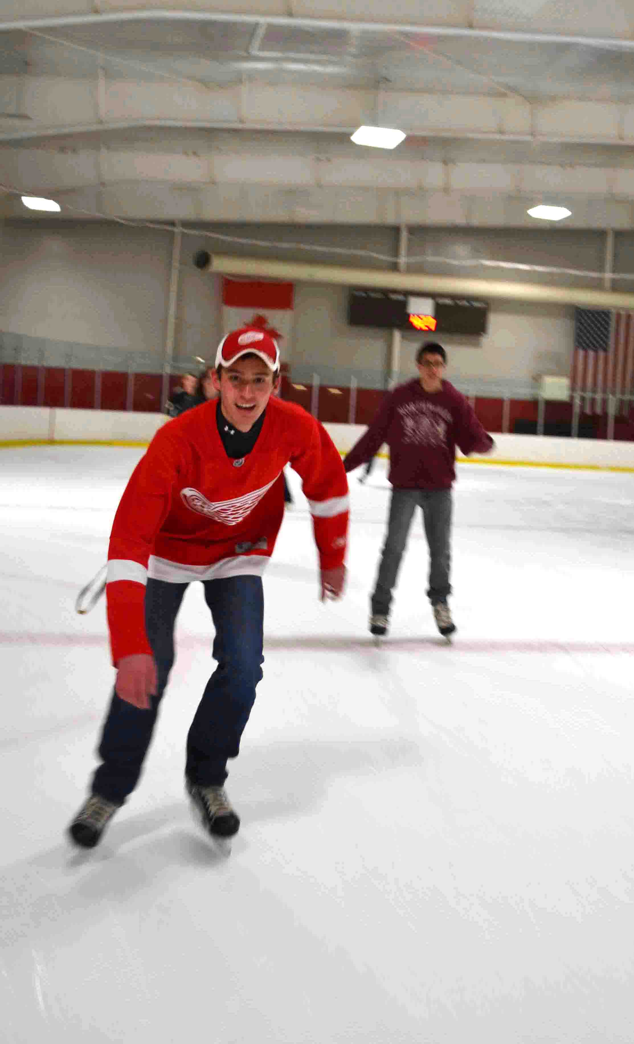 Brett Slayton flies past center ice while Gerrit Householder glides behind.