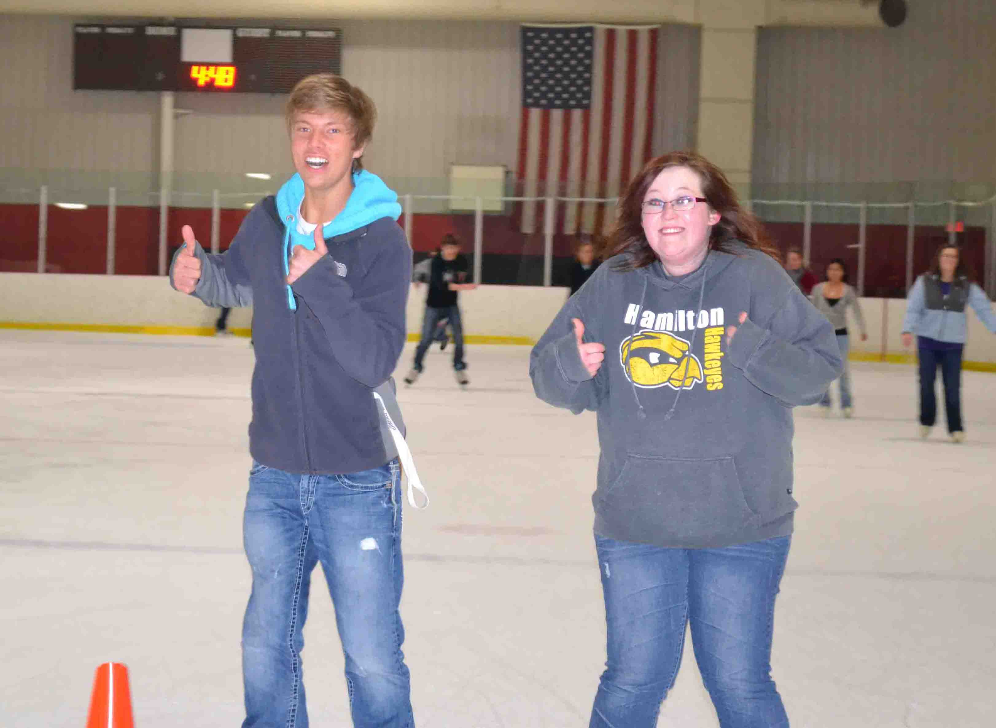 Jason and Courtney show off big smiles and thumbs UP!