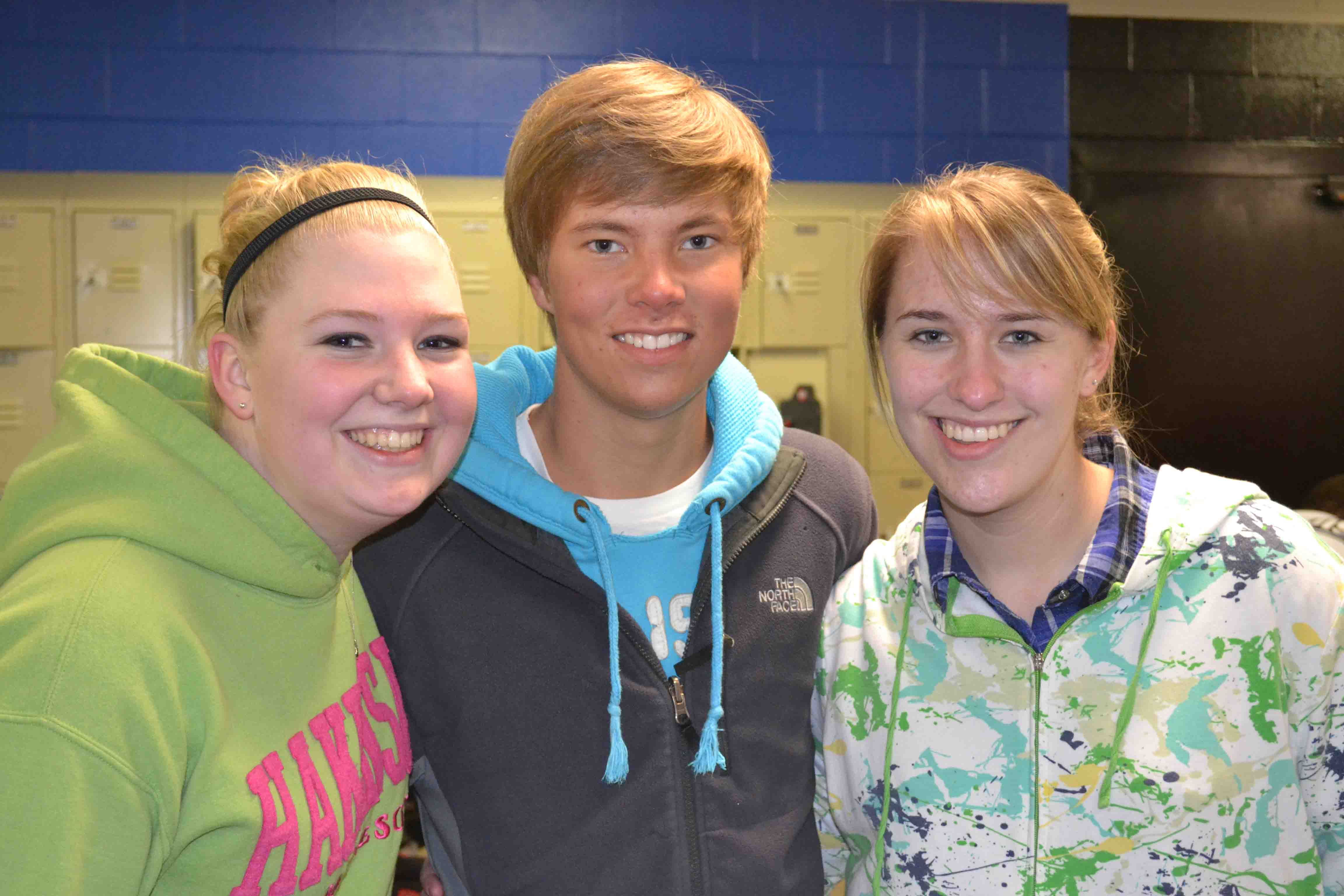Sam Gates, JT Jaesche and Raelyn Prikasky are still smiling after leaving the ice.