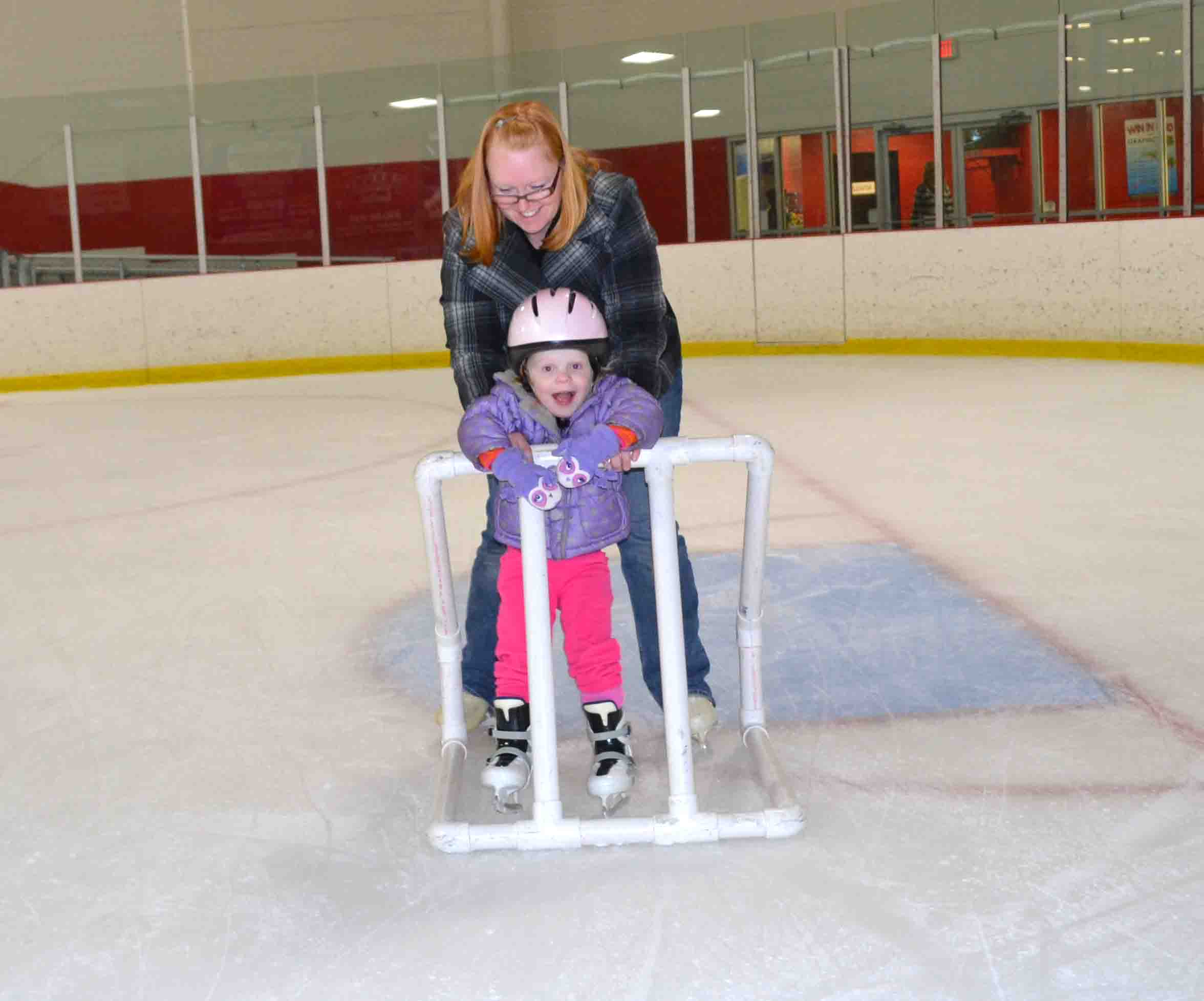 Mrs. Behnke skates around with Caroline.
