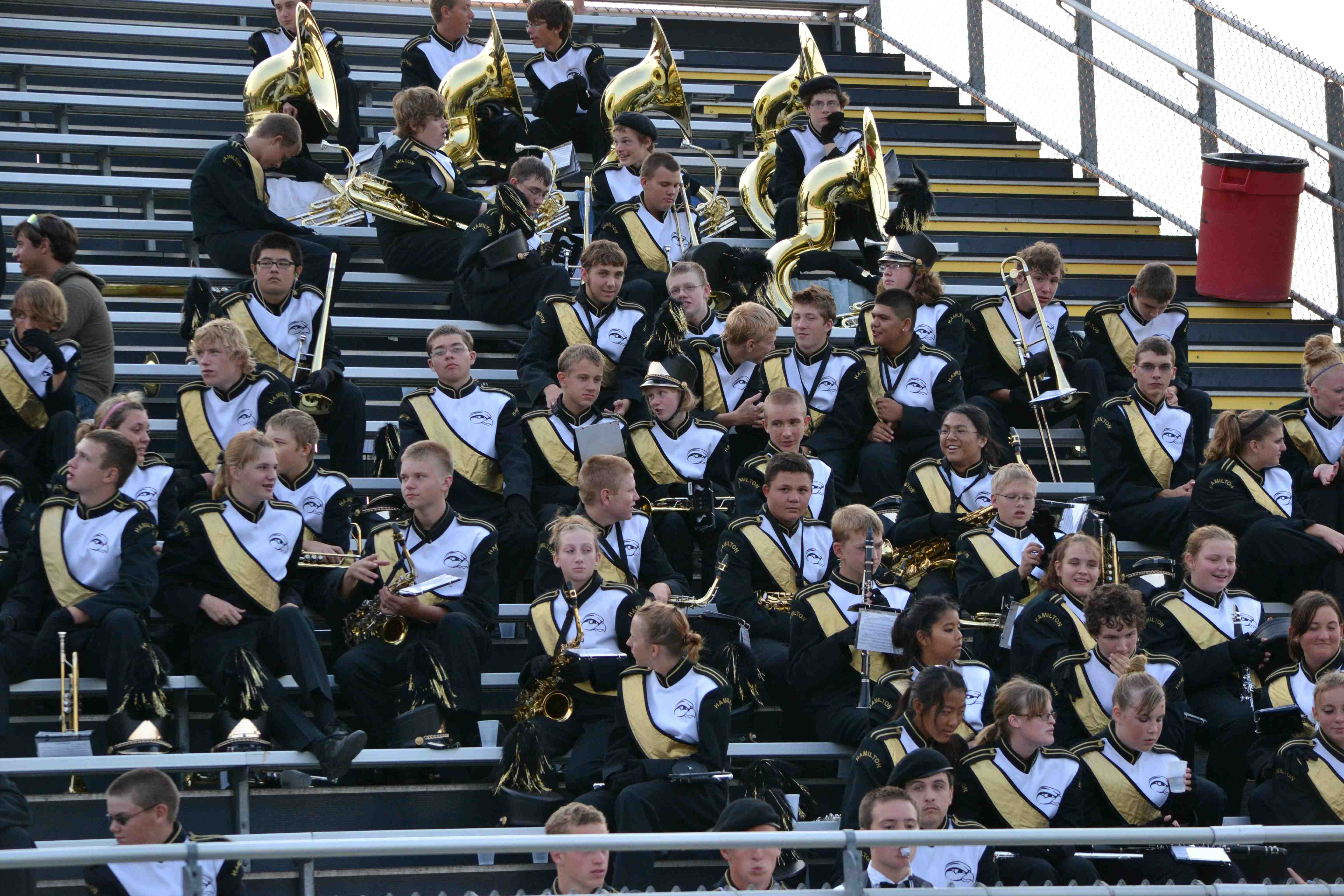 Hamilton's marching band rests between songs during the game on Thursday night.