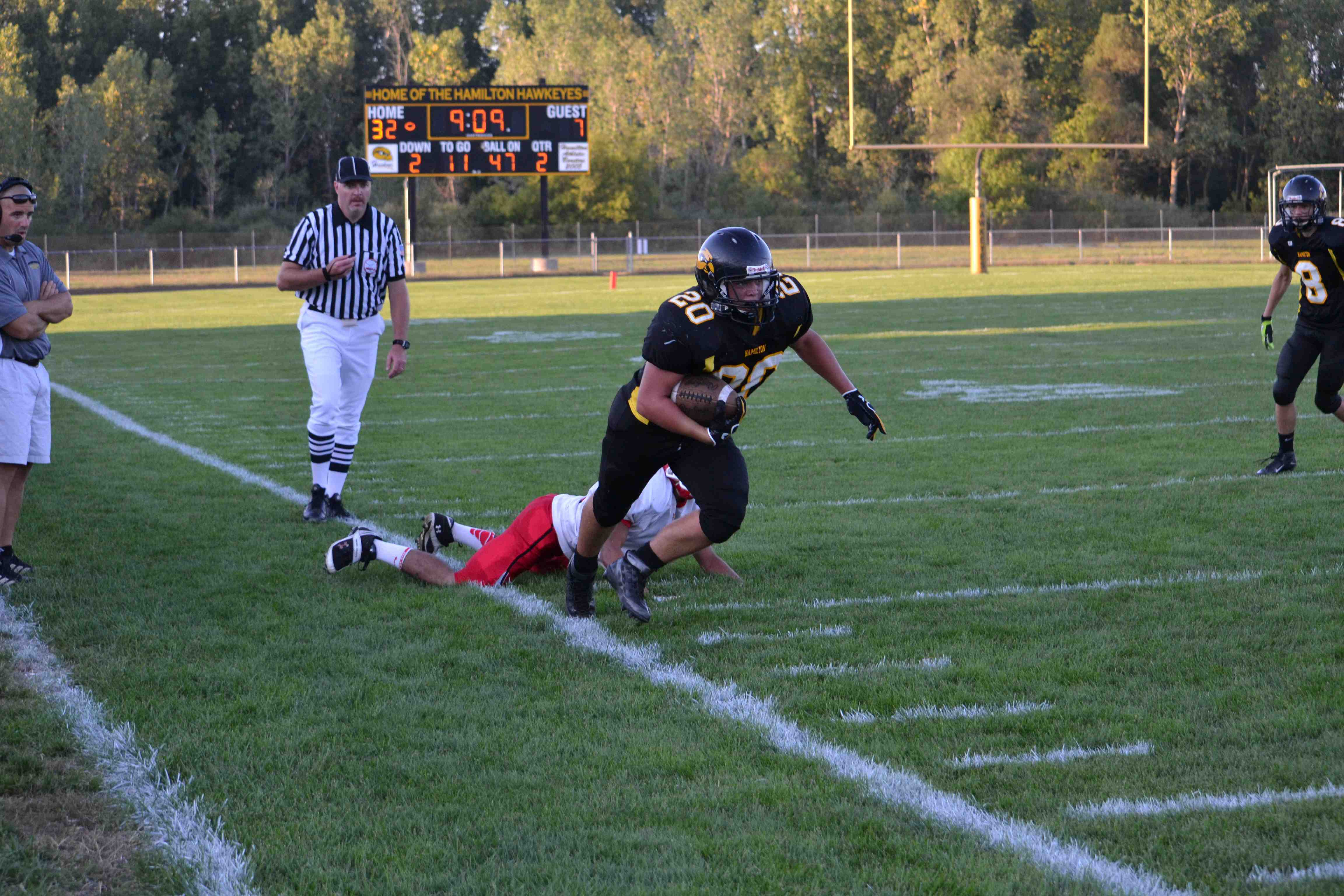 Trenton Alexander (#20) fights to stay in bounds against the Dutch.